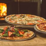 shallow focus photography of several pizzas